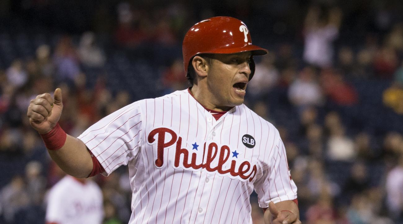 Philadelphia Phillies' Carlos Ruiz celebrates after scoring on a hit by Freddy Galvis during the fifth inning of a baseball game against the Pittsburgh Pirates, Wednesday, May 13, 2015, in Philadelphia. (AP Photo/Chris Szagola)