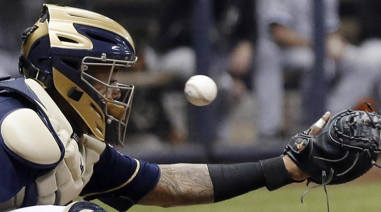 Milwaukee Brewers catcher Martin Maldonado can't catch a foul ball off the bat of Chicago White Sox's Tyler Flowers during the fifth inning of a baseball game Wednesday, May 13, 2015, in Milwaukee. (AP Photo/Morry Gash)
