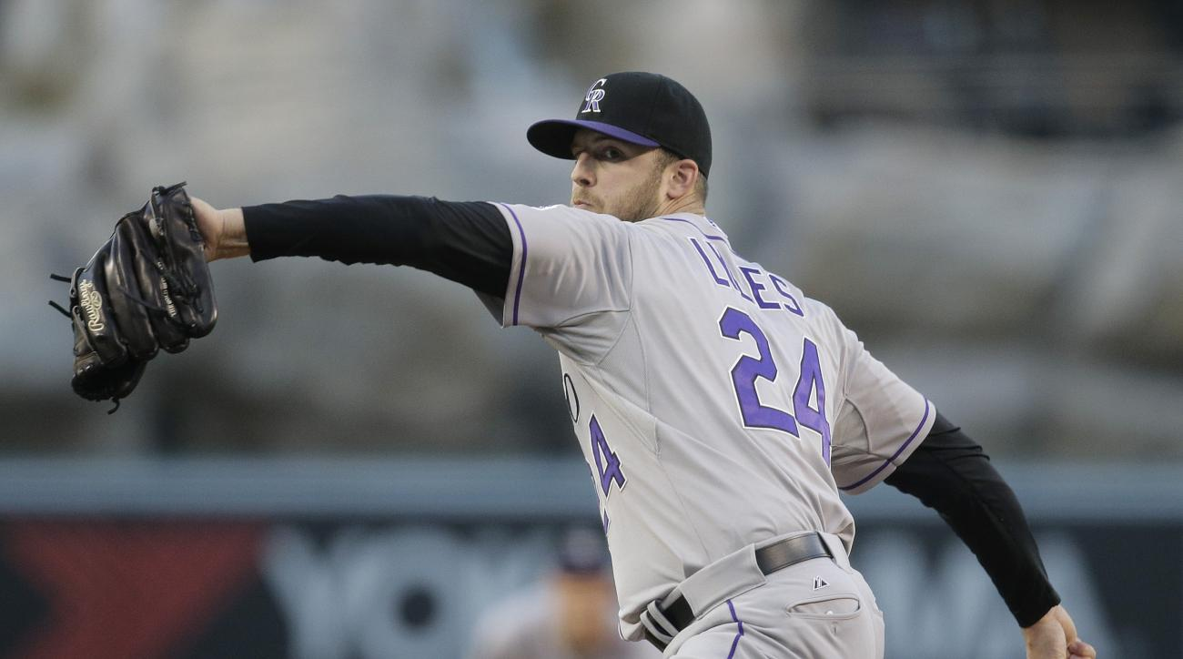 Colorado Rockies starting pitcher Jordan Lyles throws against the Los Angeles Angels during the first inning of a baseball game, Wednesday, May 13, 2015, in Anaheim, Calif. (AP Photo/Jae C. Hong)