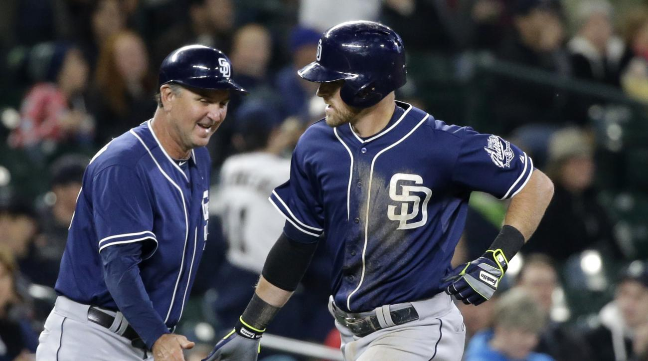 San Diego Padres' Will Middlebrooks, right, is congratulated by third base coach Glenn Hoffman on his home run against the Seattle Mariners during the third inning of a baseball game Wednesday, May 13, 2015, in Seattle. (AP Photo/Elaine Thompson)