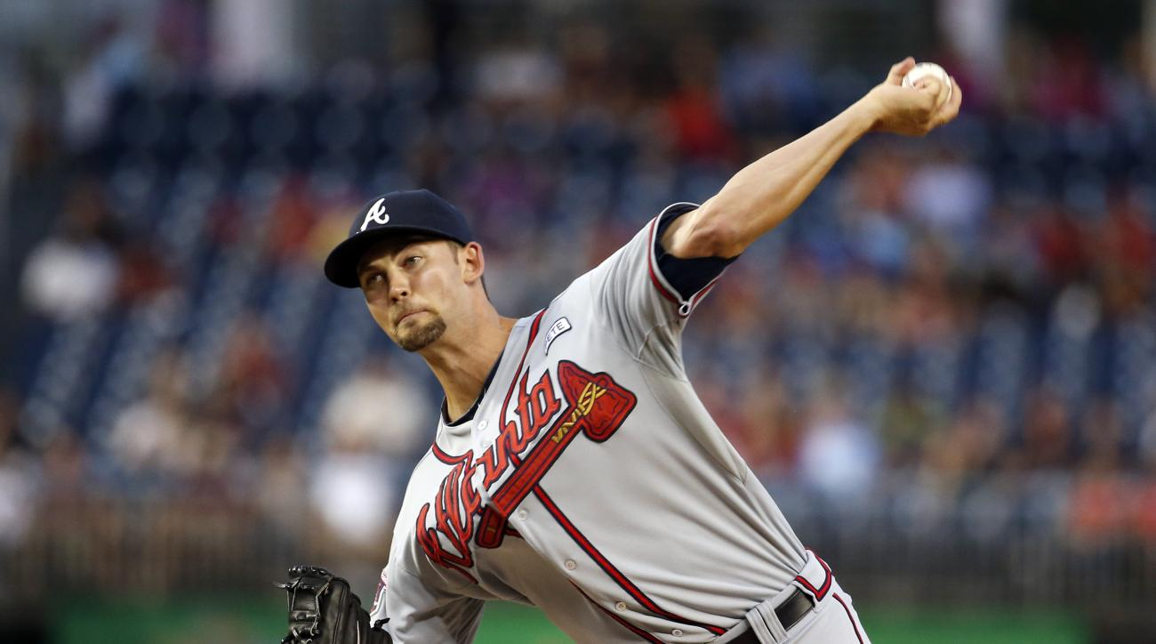 FILE - In this Sept. 8, 2014, file photo, Atlanta Braves starting pitcher Mike Minor throws during the first inning of a baseball game against the Washington Nationals at Nationals Park in Washington. Braves left-hander Mike Minor will miss the rest of th