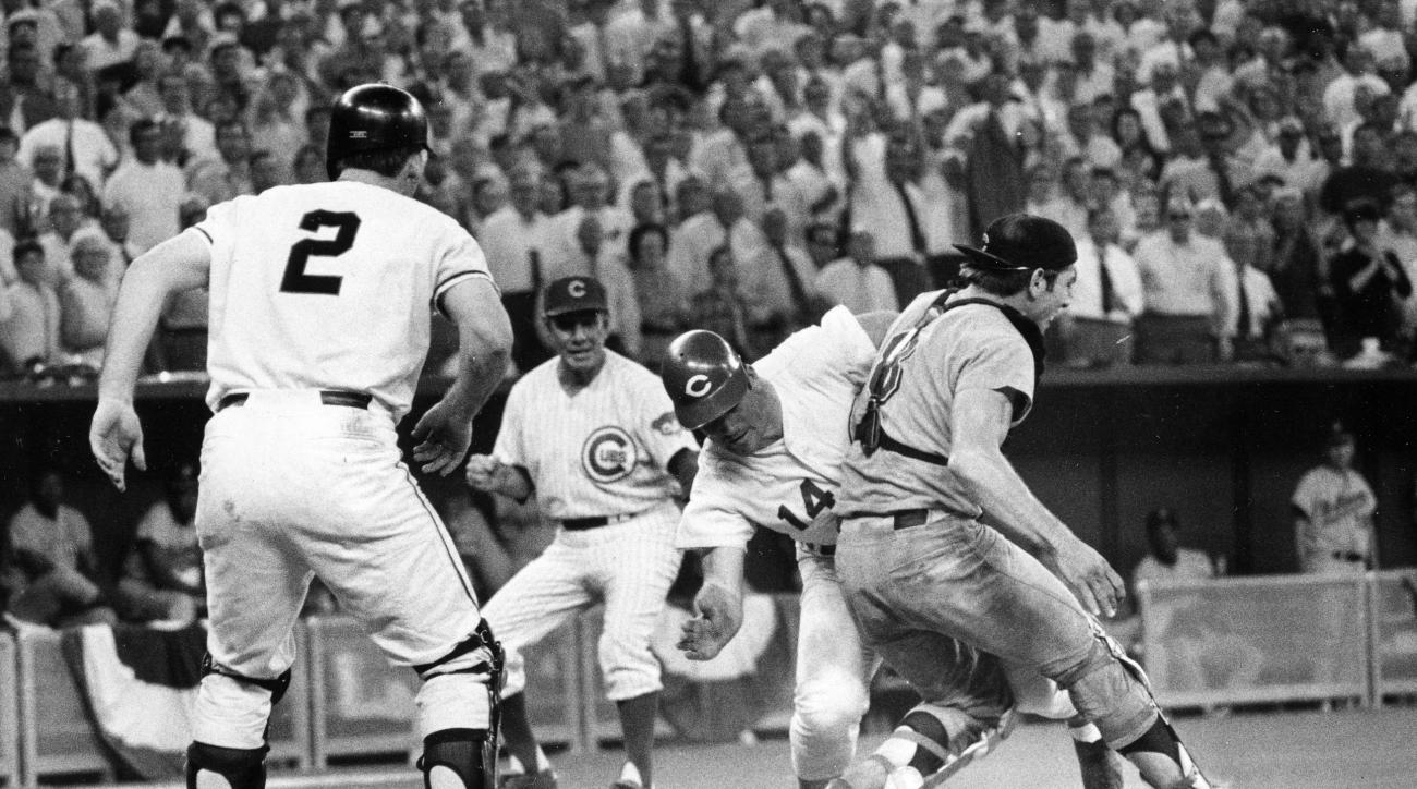 FILE - In this July 14, 1970, file photo, Cincinnati Reds' Pete Rose slams into Cleveland Indians' catcher Ray Fosse to score in the 12th inning of the 1970 All-Star Game in Cincinnati, Ohio. Looking on are the Reds' third base coach Leo Durocher, rear, a