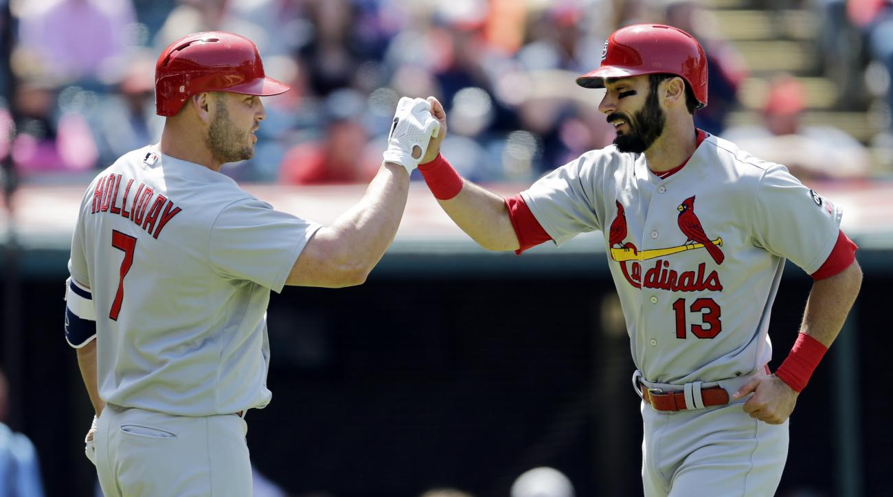 St. Louis Cardinals' Matt Carpenter (13) is congratulated by Matt Holliday (7) after Carpenter hit a two-run home run off Cleveland Indians relief pitcher Marc Rzepczynski in the eighth inning of a baseball game, Thursday, May 14, 2015, in Cleveland. Pete
