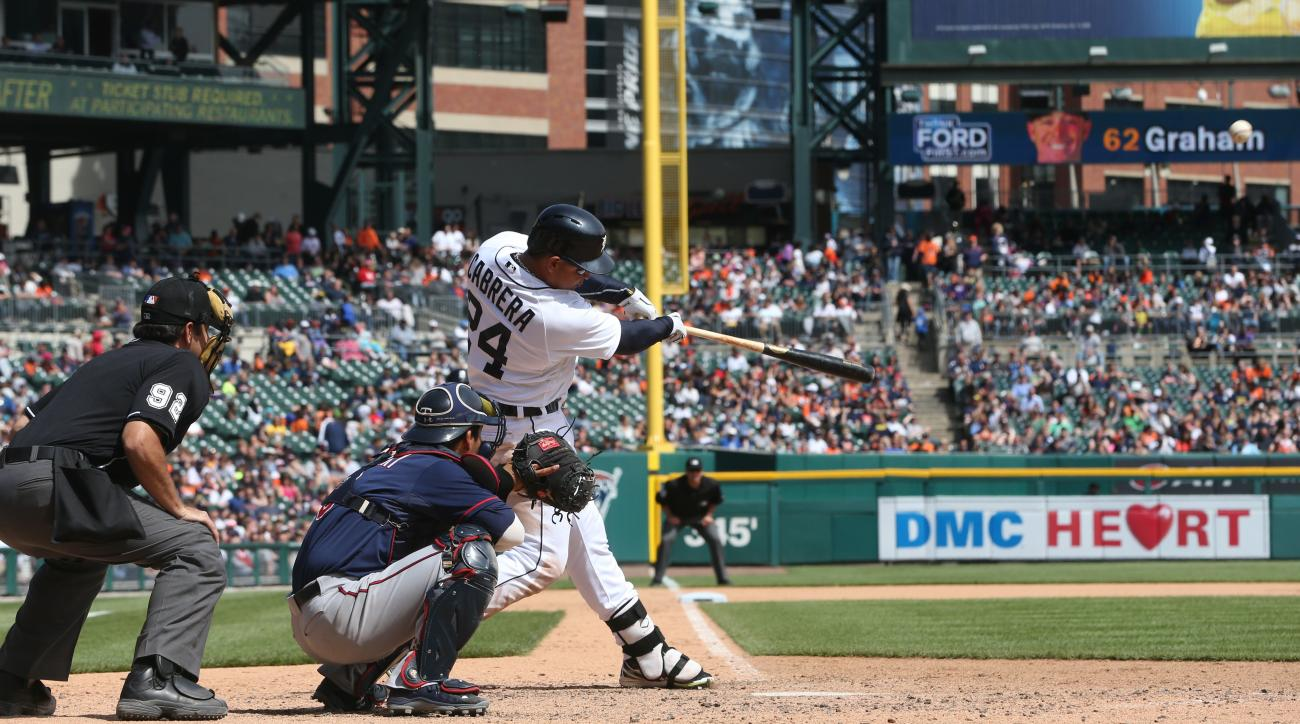 Detroit Tigers' Miguel Cabrera connects for a two-run home run during the seventh inning of a baseball game against the Minnesota Twins, Thursday, May 14, 2015, in Detroit. (AP Photo/Carlos Osorio)