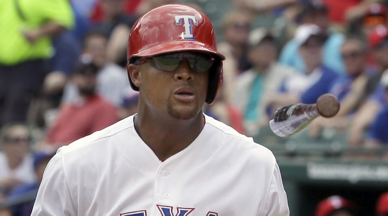 Texas Rangers Adrian Beltre tosses his bat after hitting a foul ball during the fourth inning of a baseball game Kansas City Royals in Arlington, Texas, Thursday, May 14, 2015. (AP Photo/LM Otero)