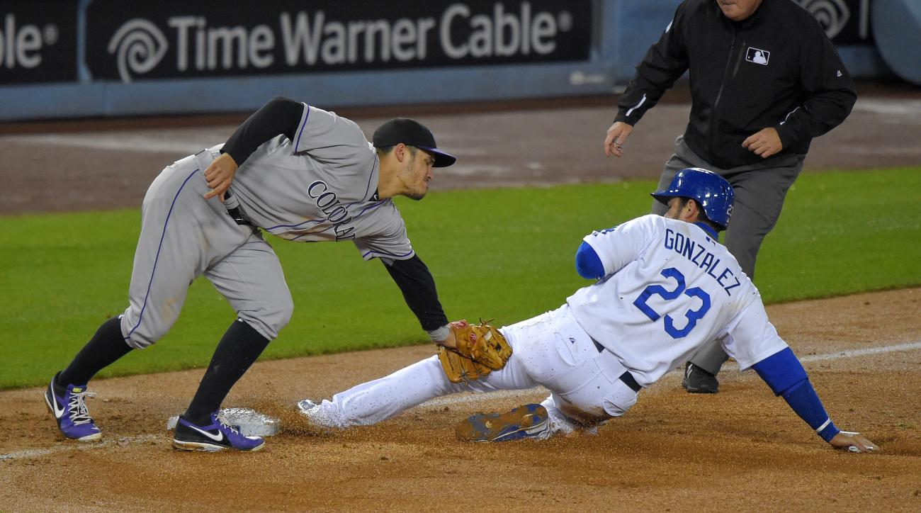 Los Angeles Dodgers' Adrian Gonzalez is tagged out at third while trying to steal by Colorado Rockies third baseman Nolan Arenado during the seventh inning of a baseball game, Thursday, May 14, 2015, in Los Angeles. (AP Photo/Mark J. Terrill)