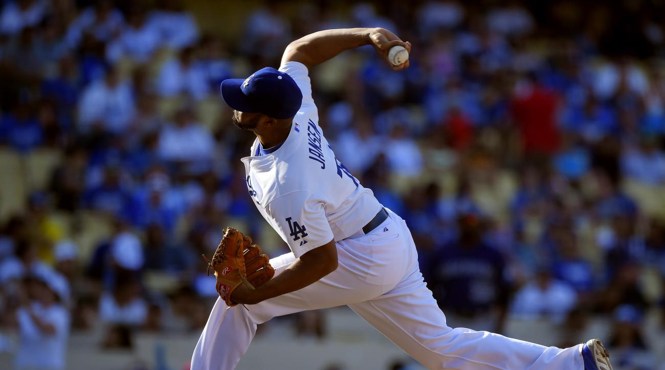 Los Angeles Dodgers relief pitcher Kenley Jansen throws to the plate during the ninth inning of a baseball game against the Colorado Rockies, Sunday, Sept. 28, 2014, in Los Angeles. The Dodgers won 10-5. (AP Photo/Mark J. Terrill)