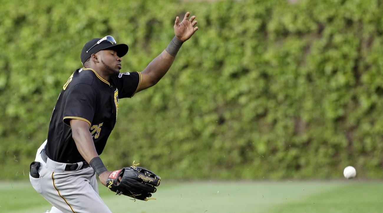 Pittsburgh Pirates right fielder Gregory Polanco can't make the catch on a single from Chicago Cubs' Matt Szczur during the 12th inning of a baseball game in Chicago, Friday, May  15, 2015. The Cubs won 11-10 in 12 innings. (AP Photo/Nam Y. Huh)