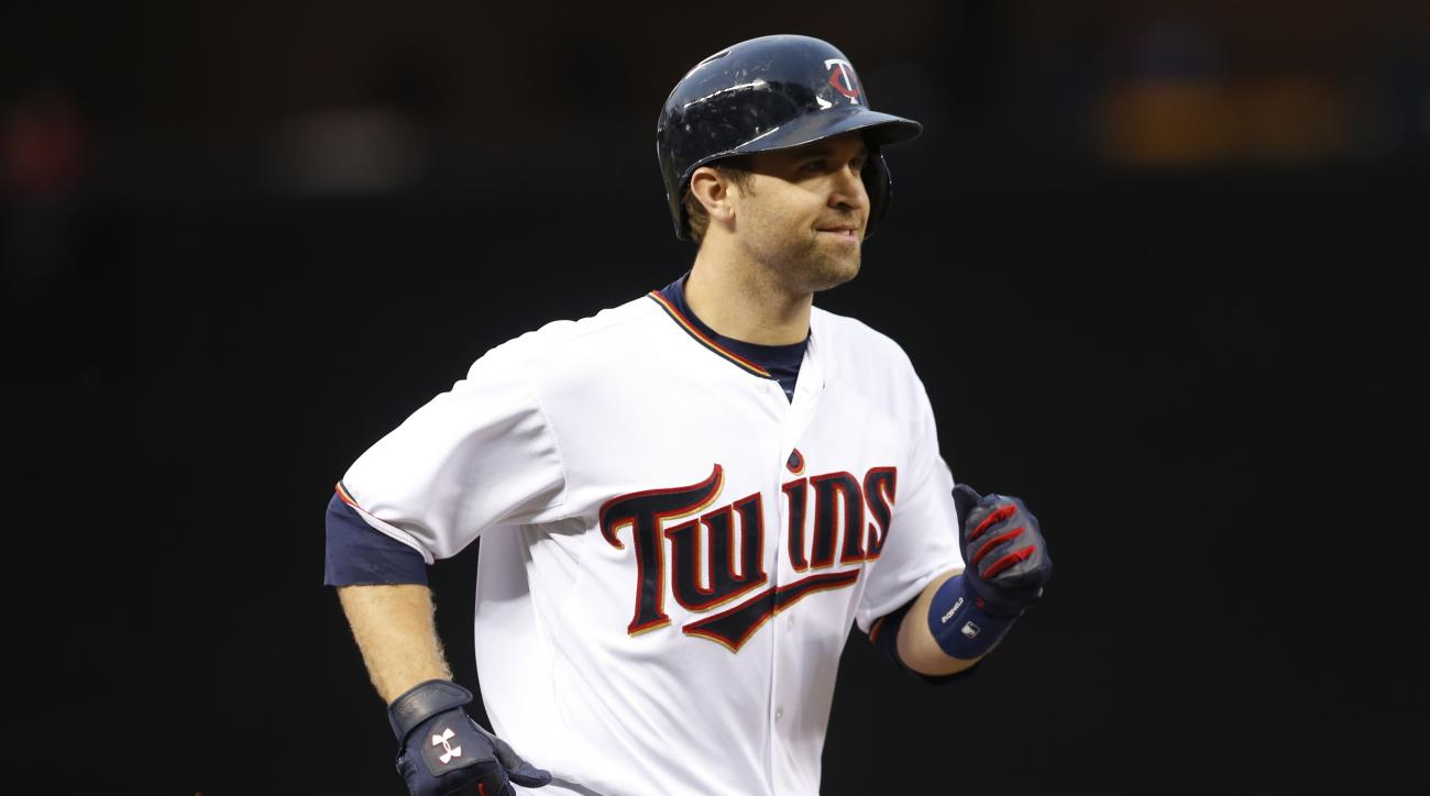 Minnesota Twins' Brian Dozier rounds the bases on a solo home run off Tampa Bay Rays pitcher Jake Odorizzi in the third inning of a baseball game, Friday, May 15, 2015, in Minneapolis. (AP Photo/Jim Mone)