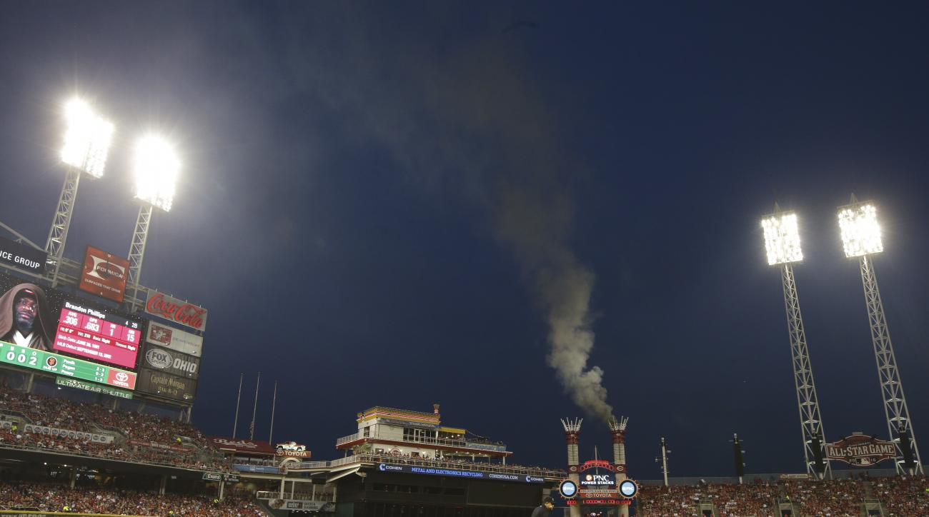 A fire burns in one of the outfield stacks at Great American Ballpark in the sixth inning of a baseball game between the San Francisco Giants and the Cincinnati Reds, Friday, May 15, 2015, in Cincinnati. (AP Photo/John Minchillo)