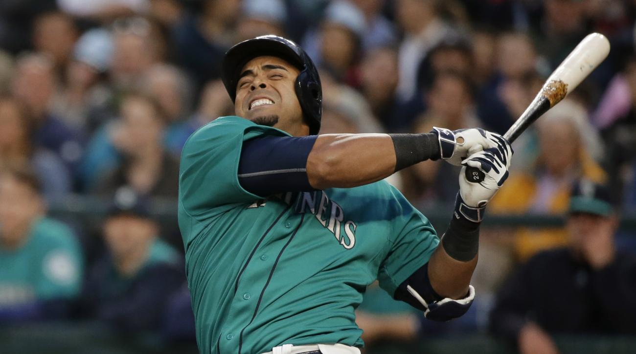 Seattle Mariners' Nelson Cruz winces as he hits a foul ball against the Boston Red Sox in the fourth inning of a baseball game, Friday, May 15, 2015, in Seattle. Cruz struck out on the at-bat. (AP Photo/Ted S. Warren)