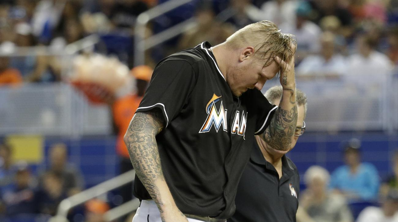 Miami Marlins starting pitcher Mat Latos walks off the field after being hit by a ball in the fourth inning of a baseball game against the Atlanta Braves, Saturday, May 16, 2015, in Miami.  (AP Photo /Lynne Sladky)