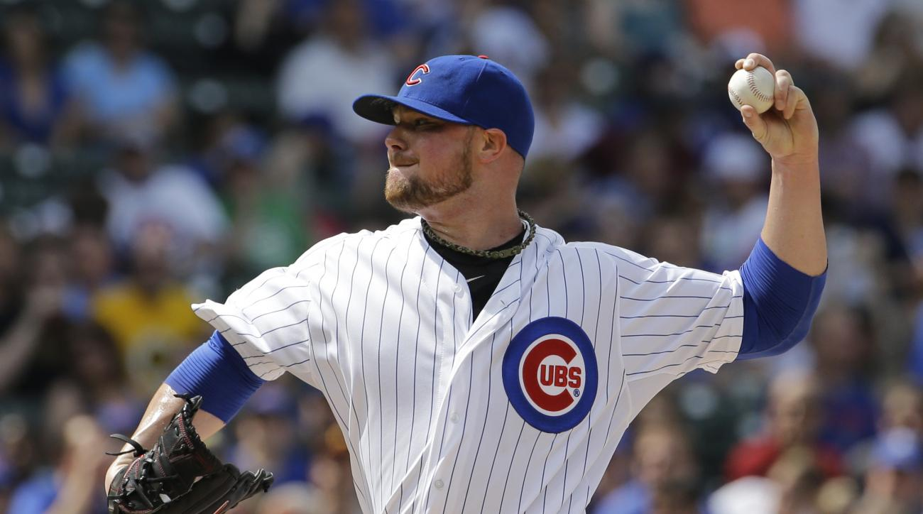 Chicago Cubs starter Jon Lester throws a pitch against the Pittsburgh Pirates during the first inning of a baseball game Saturday, May 16, 2015, in Chicago. (AP Photo/Nam Y. Huh)