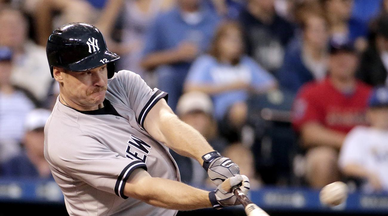 New York Yankees' Chase Headley hits a three-run home run during the fifth inning of a baseball game against the Kansas City Royals, Saturday, May 16, 2015, in Kansas City, Mo. (AP Photo/Charlie Riedel)