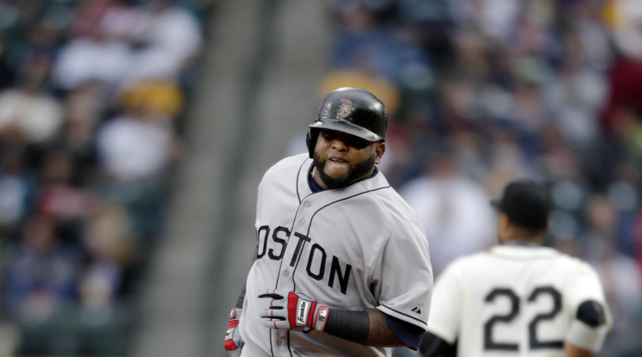 Boston Red Sox's Pablo Sandoval, left, rounds the bases after hitting a solo home run on a pitch from Seattle Mariners' Felix Hernandez during the second inning of a baseball game on Saturday, May 16, 2015, in Seattle. Both teams were wearing Negro League