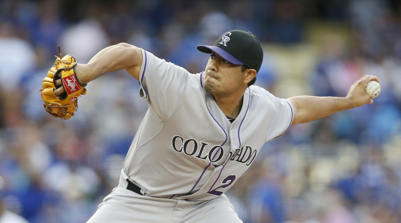 Colorado Rockies starting pitcher Jorge De La Rosa delivers against the Los Angeles Dodgers during the second inning of a baseball game, Saturday, May 16, 2015, in Los Angeles. (AP Photo/Danny Moloshok)