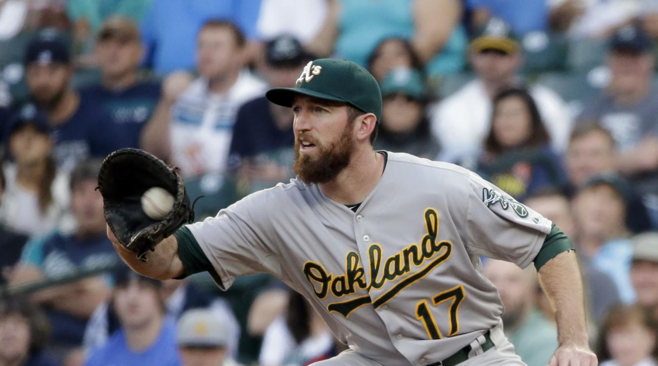 Oakland Athletics' Ike Davis in action against the Seattle Mariners in a baseball game Friday, May 8, 2015, in Seattle. (AP Photo/Elaine Thompson)