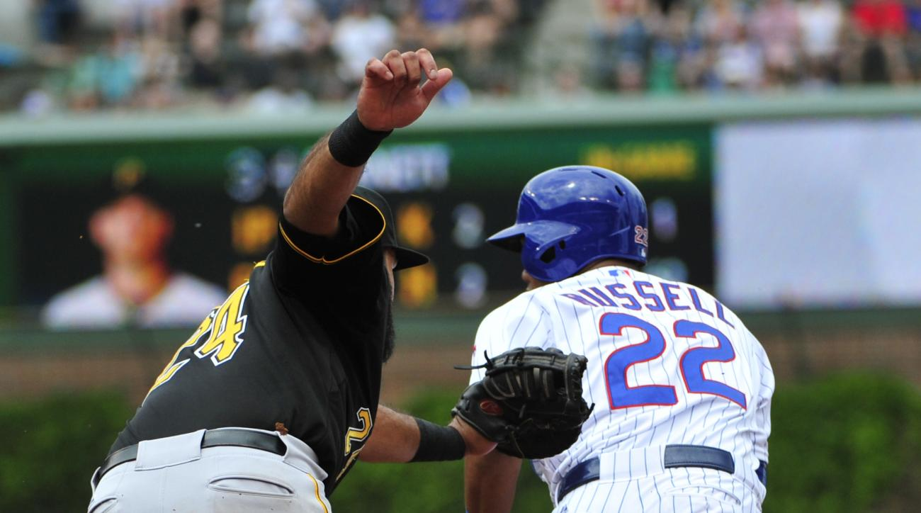 Chicago Cubs' Addison Russell (22) is tagged out by Pittsburgh Pirates first baseman Pedro Alvarez (24) on a steal attempt during the third inning of a baseball game, Sunday, May 17, 2015 in Chicago. (AP Photo/David Banks)