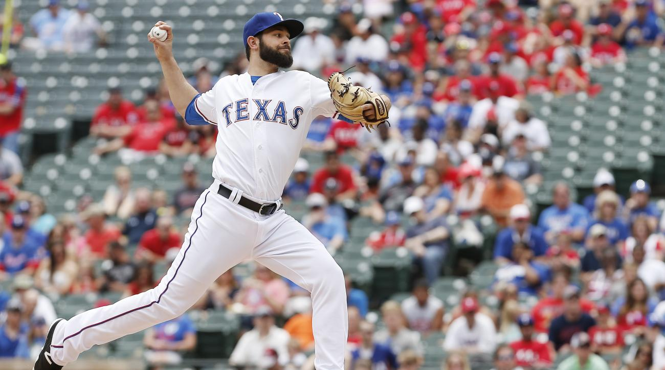 Texas Rangers starting pitcher Nick Martinez throws during the first inning of a baseball game against the Cleveland Indians, Sunday, May 17, 2015, in Arlington, Texas. (AP Photo/Brandon Wade)