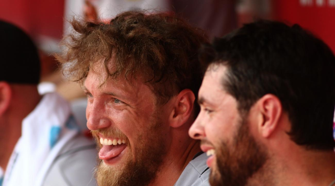 San Francisco Giants Hunter Pence, left, laughs with Brandon Belt after hitting a two run home run against the Cincinnati Reds in the third inning of a baseball game in Cincinnati, Sunday May 17, 2015. (AP Photo/Tom Uhlman)