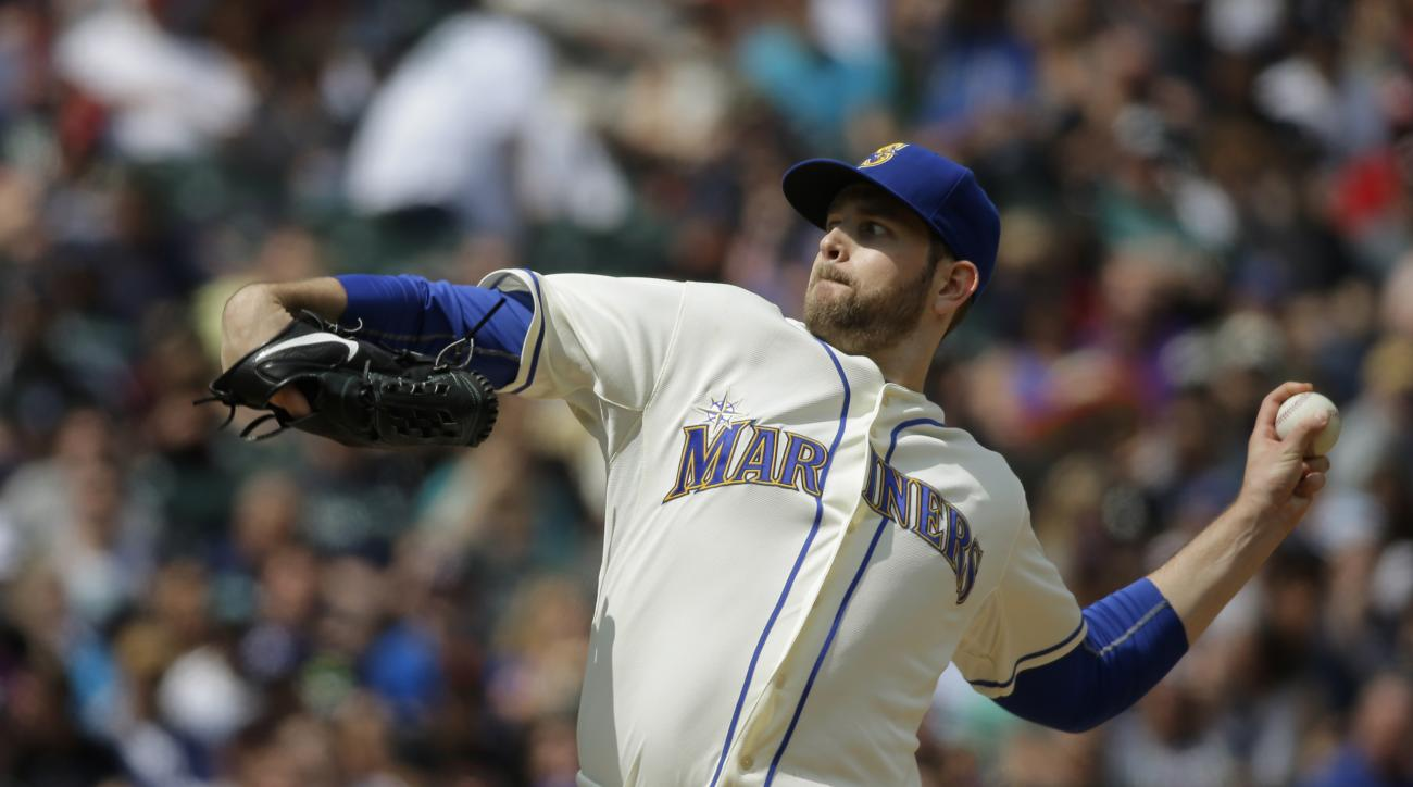 Seattle Mariners starting pitcher James Paxton throws against the Boston Red Sox in the sixth inning of a baseball game, Sunday, May 17, 2015, in Seattle. (AP Photo/Ted S. Warren)