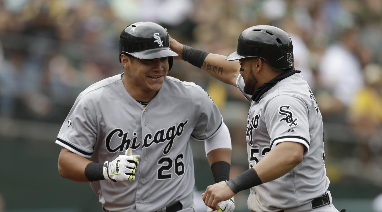 Chicago White Sox's Avisail Garcia, left, and Melky Cabrera celebrate after Garcia hit a two-run home run off Oakland Athletics' Tyler Clippard in the ninth inning of a baseball game Sunday, May 17, 2015, in Oakland, Calif. (AP Photo/Ben Margot)