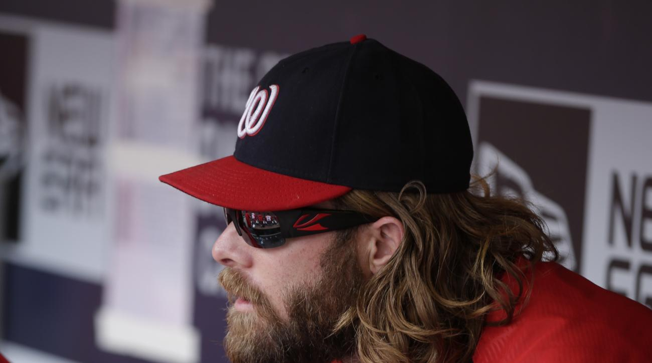 Washington Nationals left fielder Jayson Werth sits in the dugout with his wrist wrapped as the Nationals take on the San Diego Padres during the eighth inning in a baseball game, Sunday, May 17, 2015, in San Diego. (AP Photo/Gregory Bull)