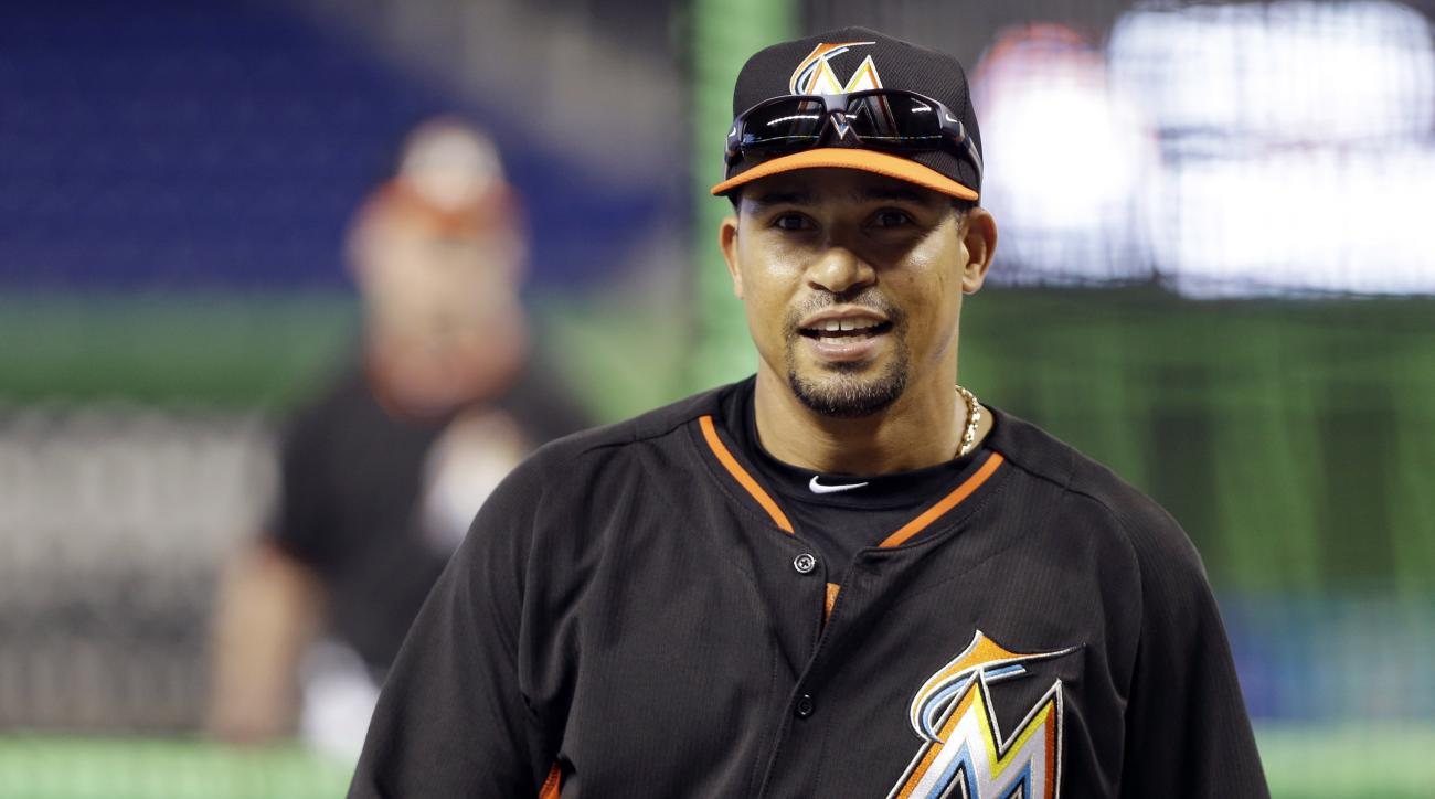 FILE - In this Wednesday, April 30, 2014 file photo, Miami Marlins second baseman Rafael Furcal (15)  smiles during batting practice before a baseball game against the against the Atlanta Braves in Miami. Former NL Rookie of the Year Rafael Furcal is reti