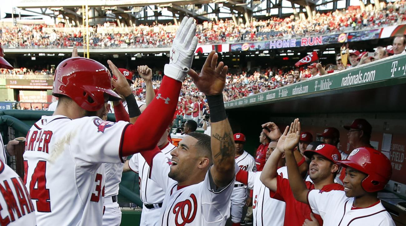 Washington Nationals' Bryce Harper, left, celebrates his solo home run with Ian Desmond, who also hit a solo home run during the first inning of an interleague baseball game against the New York Yankees at Nationals Park, Tuesday, May 19, 2015, in Washing