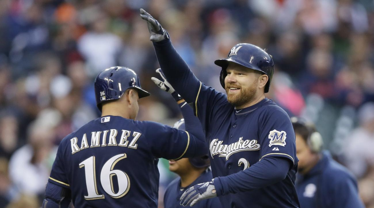 Milwaukee Brewers' Adam Lind is high-fived, after his home run, by teammate Aramis Ramirez off Detroit Tigers starting pitcher Anibal Sanchez during the third inning of an interleague baseball game, Tuesday, May 19, 2015, in Detroit. (AP Photo/Carlos Osor