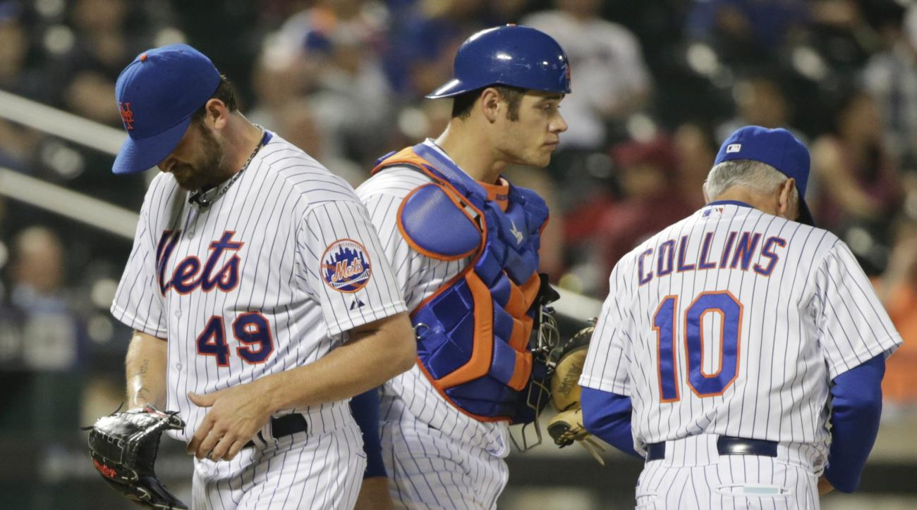 New York Mets starting pitcher Jonathon Niese (49) leaves the baseball game during the sixth inning against the St. Louis Cardinals as catcher Anthony Recker and manager Terry Collins (10) look away Tuesday, May 19, 2015, in New York. (AP Photo/Frank Fran