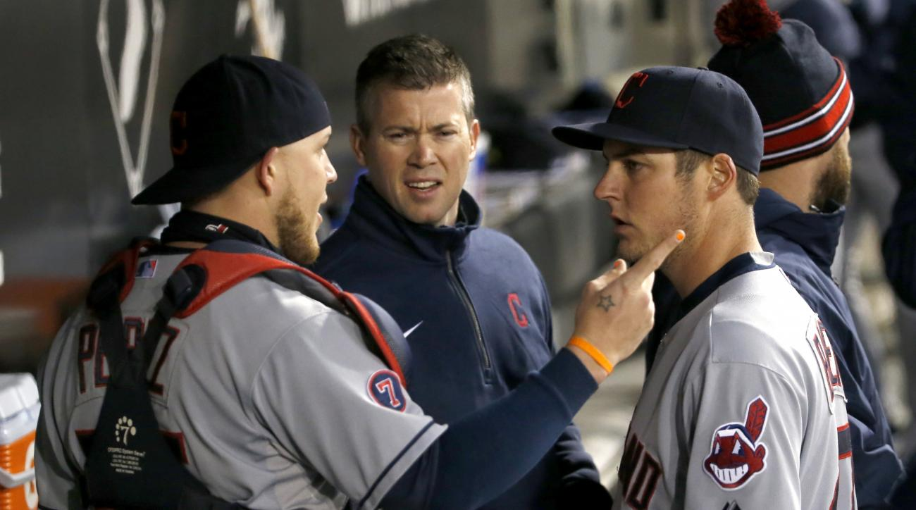 Cleveland Indians catcher Roberto Perez, left, talks to starting pitcher Trevor Bauer in the dugout after the fourth inning of a baseball game against the Chicago White Sox Tuesday, May 19, 2015, in Chicago. The man in the middle is unidentified. (AP Phot