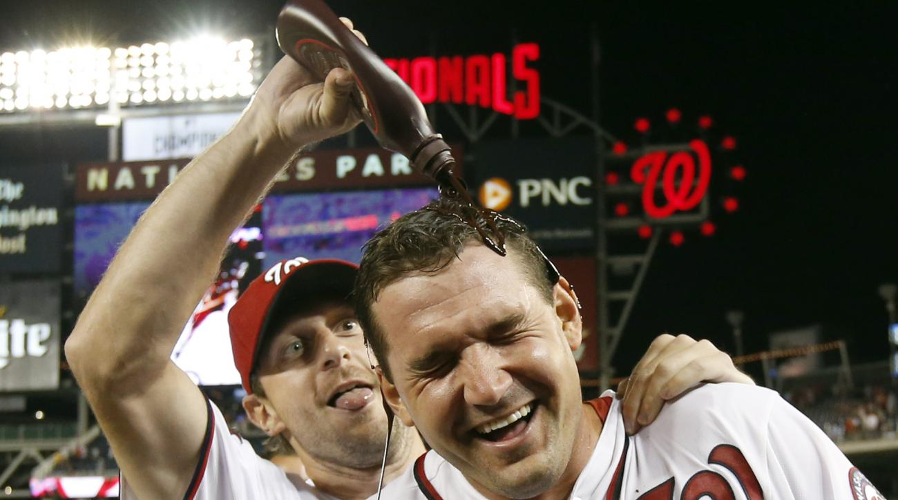 Washington Nationals' Ryan Zimmerman gets doused with chocolate syrup by Max Scherzer after an interleague baseball game against the New York Yankees at Nationals Park, Tuesday, May 19, 2015, in Washington.  Zimmerman hit a two-run walk off home run.  The