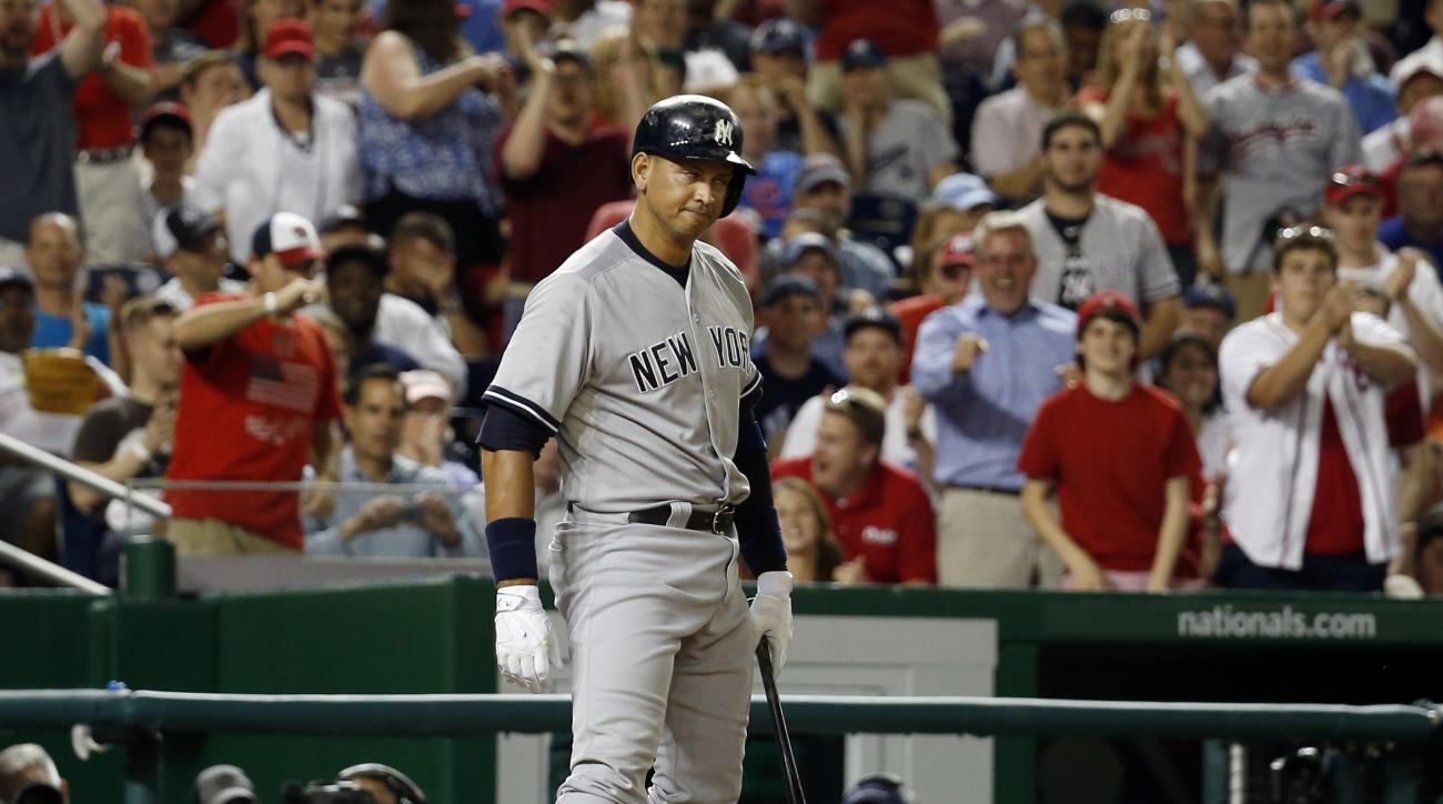 New York Yankees' Alex Rodriguez (13) reacts after he struck out during the ninth inning of an interleague baseball game against the Washington Nationals at Nationals Park, Tuesday, May 19, 2015, in Washington. The Nationals won 8-6 in 10 innings. (AP Pho