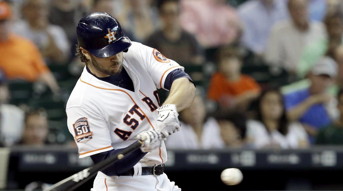 Houston Astros' Jake Marisnick connects for an RBI single against the Oakland Athletics in the third inning of a baseball game Wednesday, May 20, 2015, in Houston. (AP Photo/Pat Sullivan)