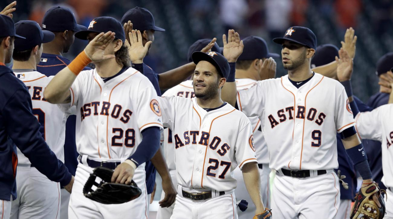 Houston Astros Colby Rasmus (28), Jose Altuve (27) and Marwin Gonzalez celebrate their 6-1 win over the Oakland Athletics in a baseball game Wednesday, May 20, 2015, in Houston. (AP Photo/Pat Sullivan)
