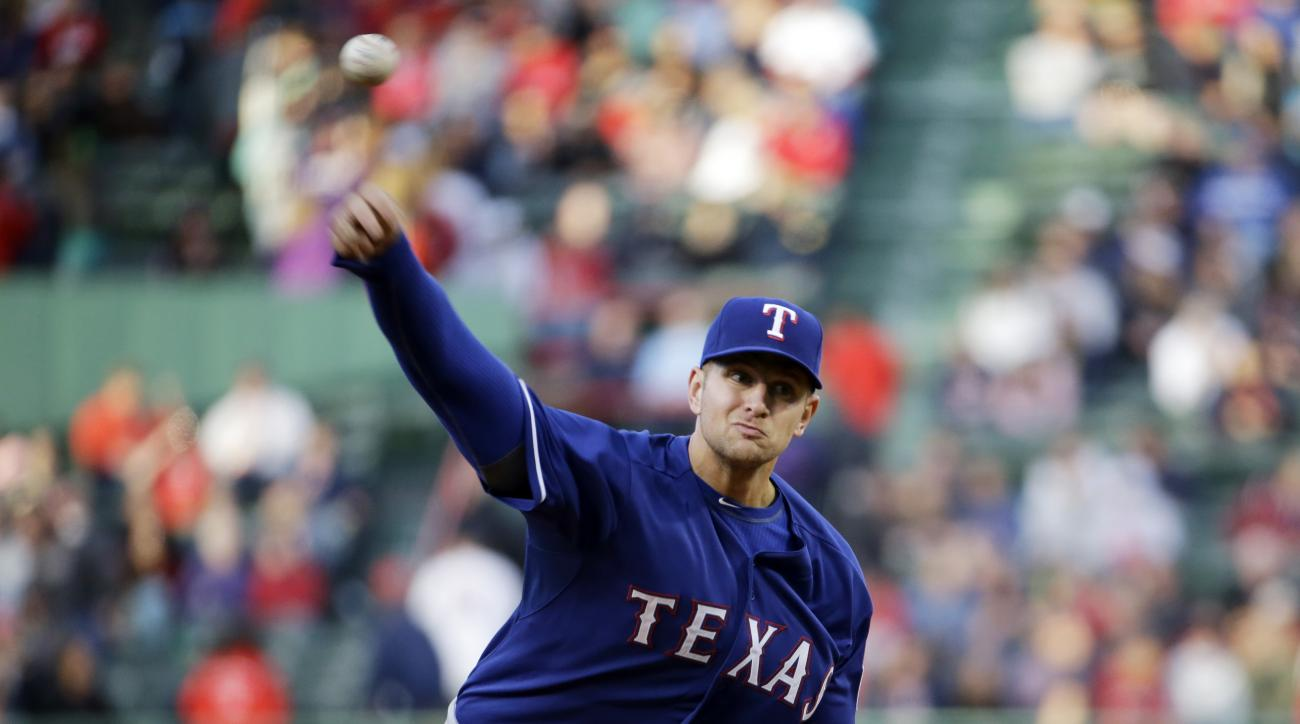 Texas Rangers starting pitcher Phil Klein delivers to the Boston Red Sox during the first inning of a baseball game at Fenway Park on Wednesday, May 20, 2015, in Boston. (AP Photo/Elise Amendola)