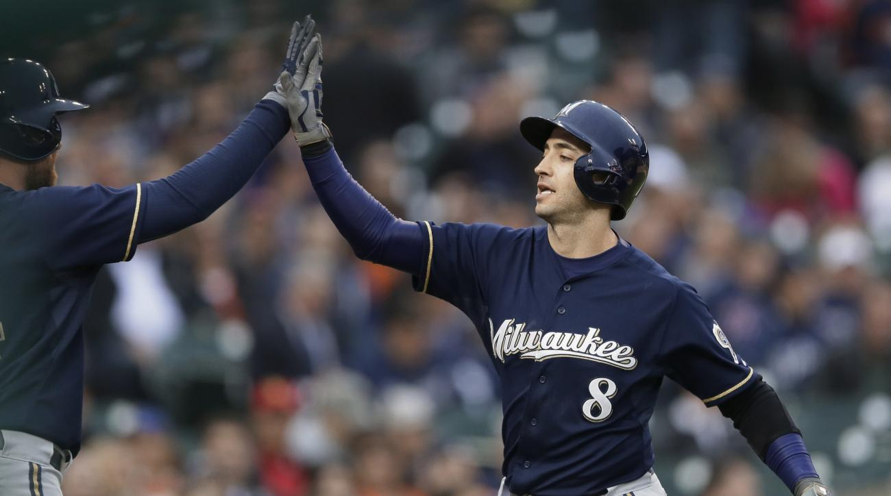 Milwaukee Brewers' Ryan Braun is congratulated after his solo home run off Detroit Tigers starting pitcher Shane Greene during the fourth inning of an interleague baseball game, Wednesday, May 20, 2015, in Detroit. (AP Photo/Carlos Osorio)