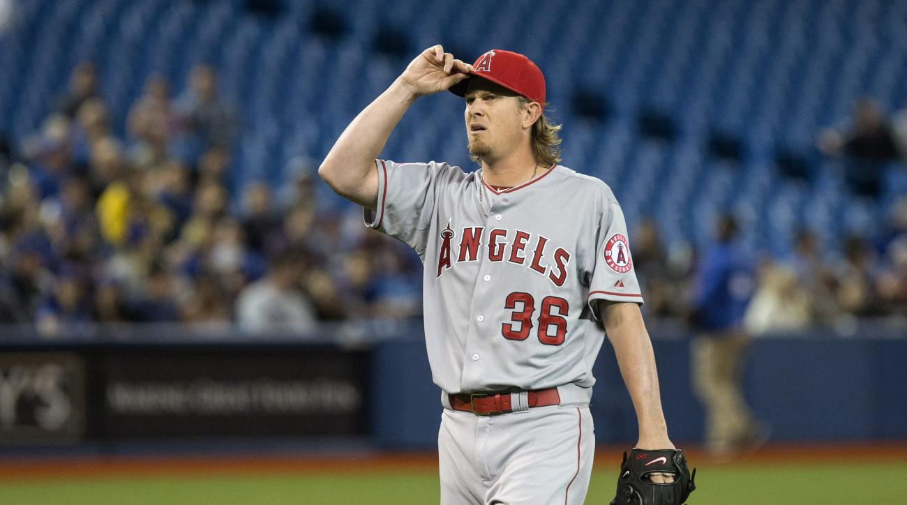 Los Angeles Angels' Jered Weaver makes his way to the dugout after the second inning of a baseball game against the Toronto Blue Jays, Wednesday, May 20, 2015 in Toronto.  (Chris Young /The Canadian Press via AP) MANDATORY CREDIT