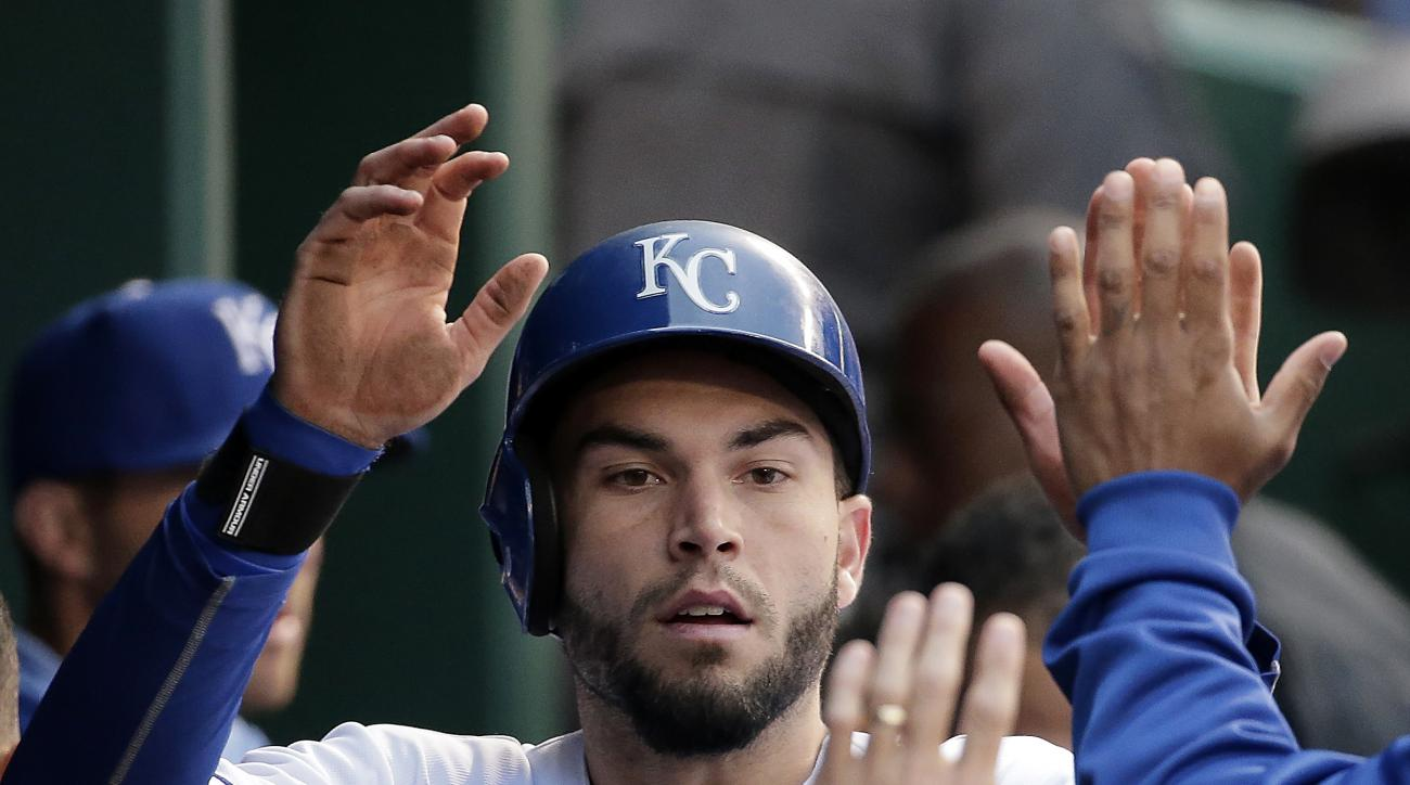 Kansas City Royals' Eric Hosmer celebrates in the dugout after scoring on a sacrifice fly by Alex Gordon during the second inning of a baseball game against the Cincinnati Reds Wednesday, May 20, 2015, in Kansas City, Mo. (AP Photo/Charlie Riedel)