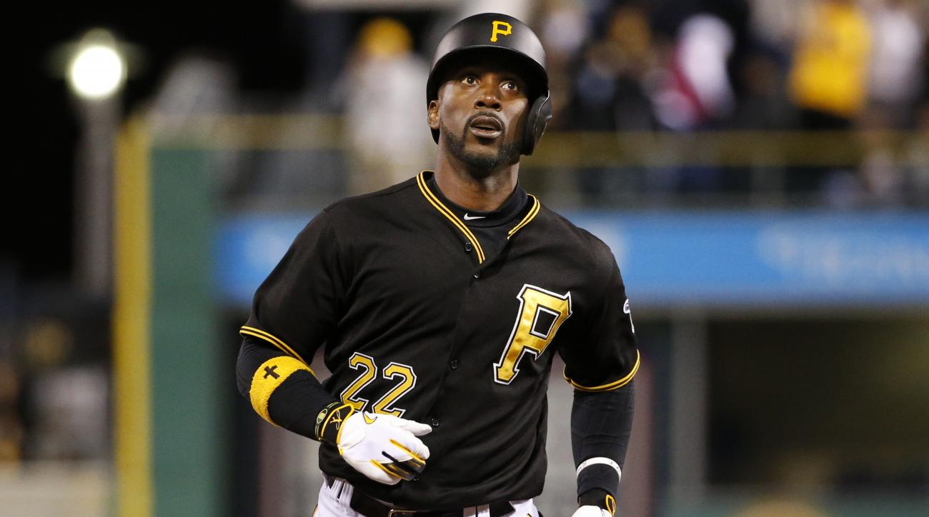 Pittsburgh Pirates' Andrew McCutchen (22) rounds second after hitting a solo-home run off Minnesota Twins relief pitcher Blaine Boyer during eighth inning of a baseball game in Pittsburgh Wednesday, May 20, 2015.(AP Photo/Gene J. Puskar)