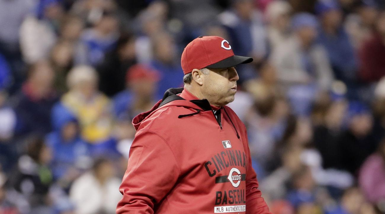 Cincinnati Reds manager Bryan Price walks to the mound to make a pitching change during the fourth inning of a baseball game against the Kansas City Royals  Wednesday, May 20, 2015, in Kansas City, Mo. (AP Photo/Charlie Riedel)