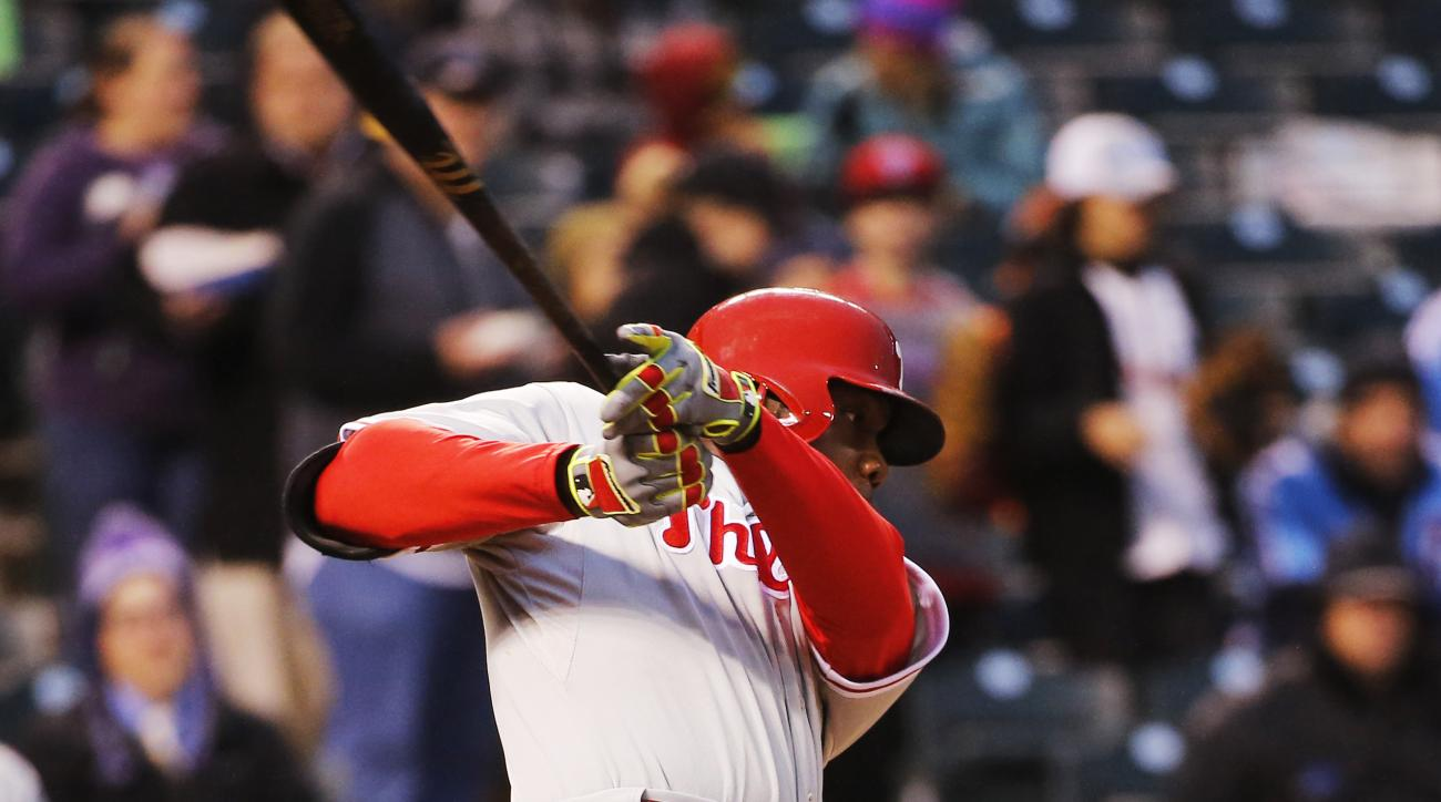 Philadelphia Phillies' Ryan Howard hits a ground ball against the Colorado Rockies during the fourth inning of a baseball game Wednesday, May 20, 2015, in Denver.  (AP Photo/Jack Dempsey)