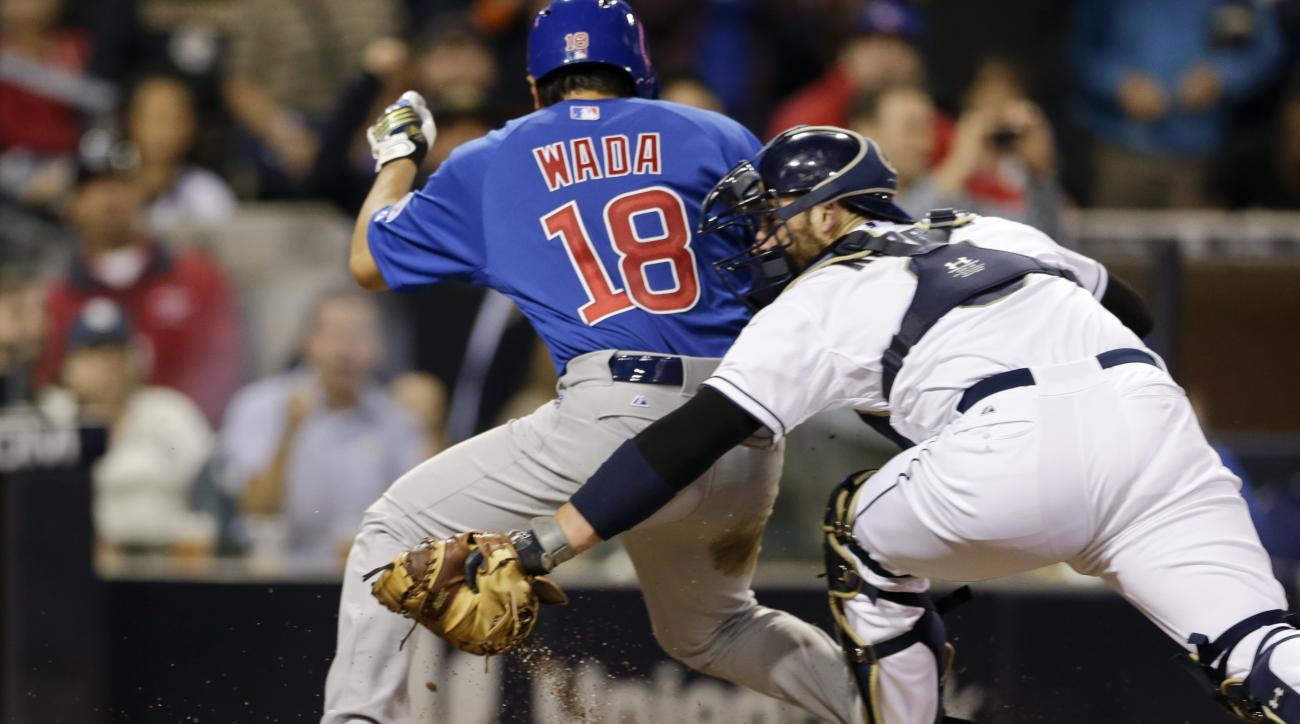 Chicago Cubs' Tsuyoshi Wada (18) scores on a triple by Dexter Fowler as San Diego Padres catcher Derek Norris applies the tag too late during the fifth inning in a baseball game Wednesday, May 20, 2015, in San Diego. (AP Photo/Gregory Bull)
