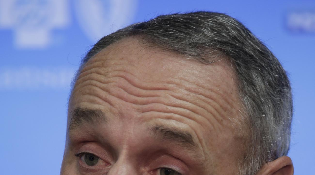 MLB Commissioner Rob Manfred talks to the media before a baseball game between the Kansas City Royals and the Cleveland Indians  Thursday, May 7, 2015, in Kansas City, Mo. (AP Photo/Charlie Riedel)
