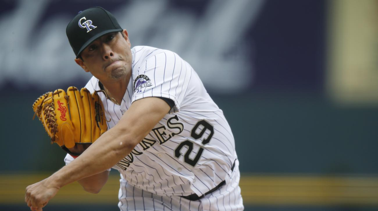 Colorado Rockies starting pitcher Jorge De La Rosa works against the Philadelphia Phillies in the first inning of a baseball game Thursday, May 21, 2015, in Denver. (AP Photo/David Zalubowski)