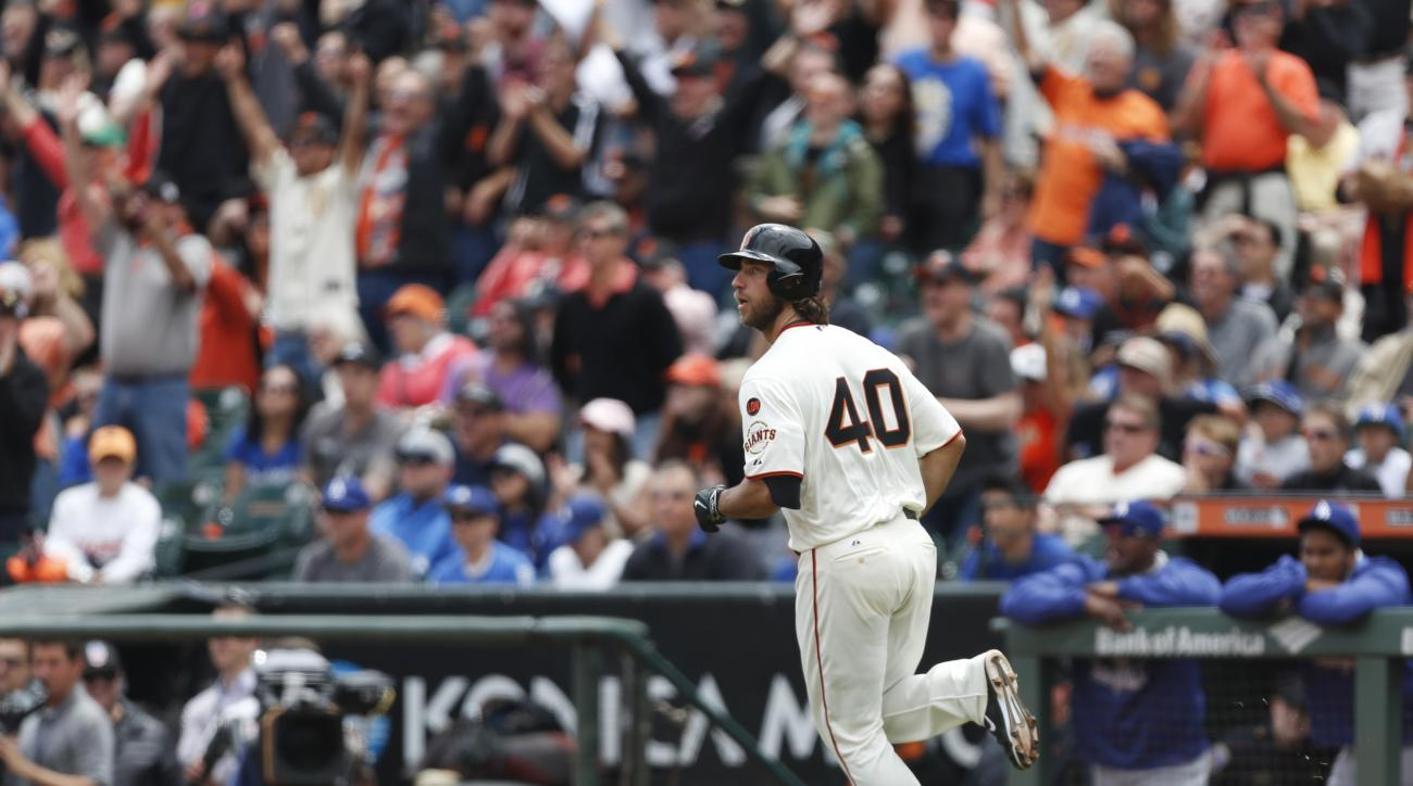 San Francisco Giants pitcher Madison Bumgarner watches his home run ball during the third inning of a baseball game against the Los Angeles Dodgers, Thursday, May 21, 2015, in San Francisco. (AP Photo/Beck Diefenbach)