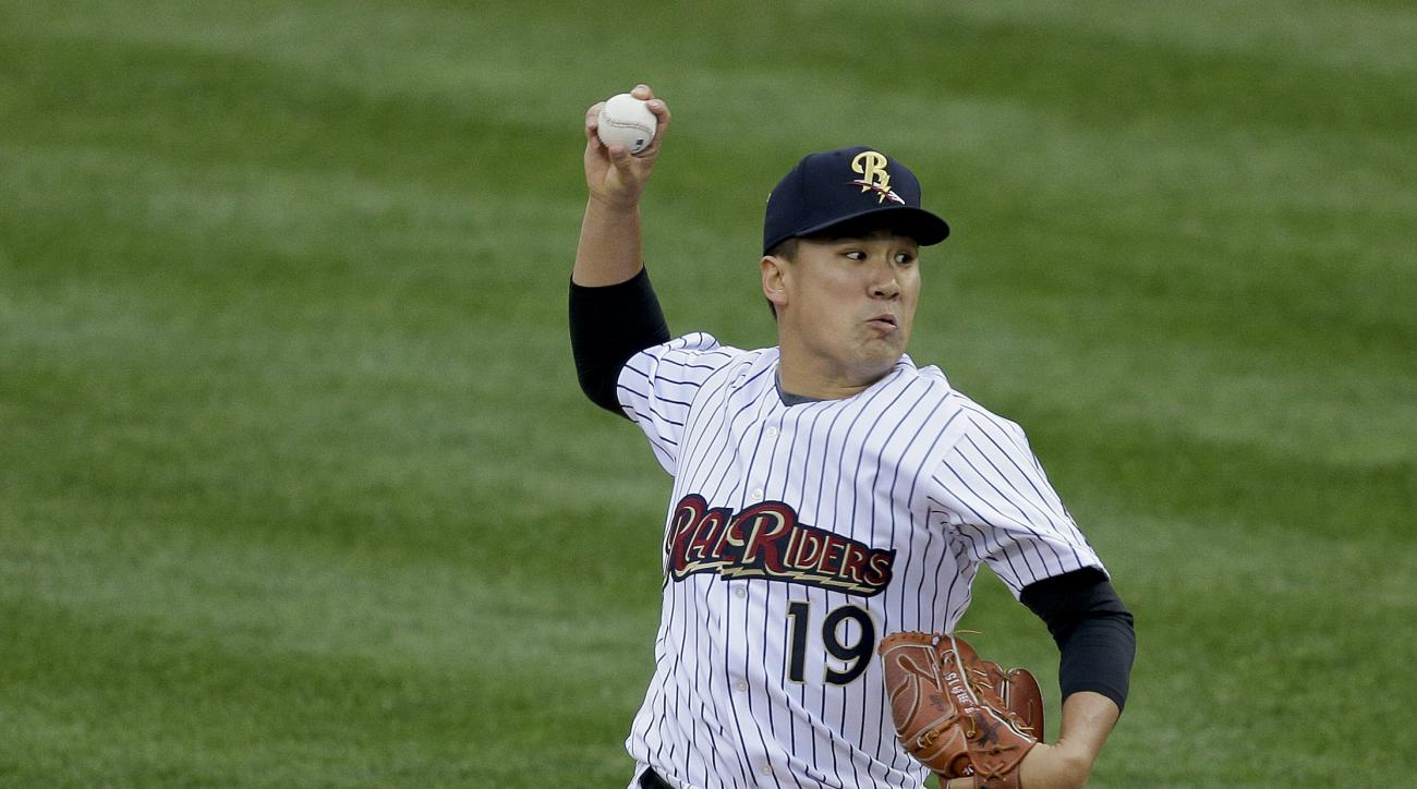 New York Yankees pitcher Masahiro Tanaka, playing for the Triple A Scranton/Wilkes Barre RailRiders delivers against the Durham Bulls during the second inning of a baseball game, Thursday, May 21, 2015, in Scranton, Pa. Tanaka threw 41 pitches and gave up