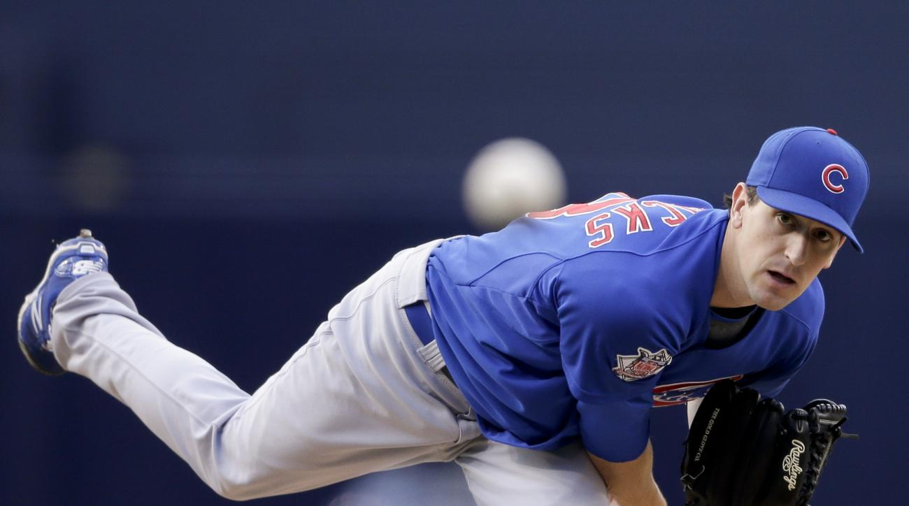 Chicago Cubs starting pitcher Kyle Hendricks throws to a San Diego Padres batter during the first inning in a baseball game Thursday, May 21, 2015, in San Diego. (AP Photo/Gregory Bull)