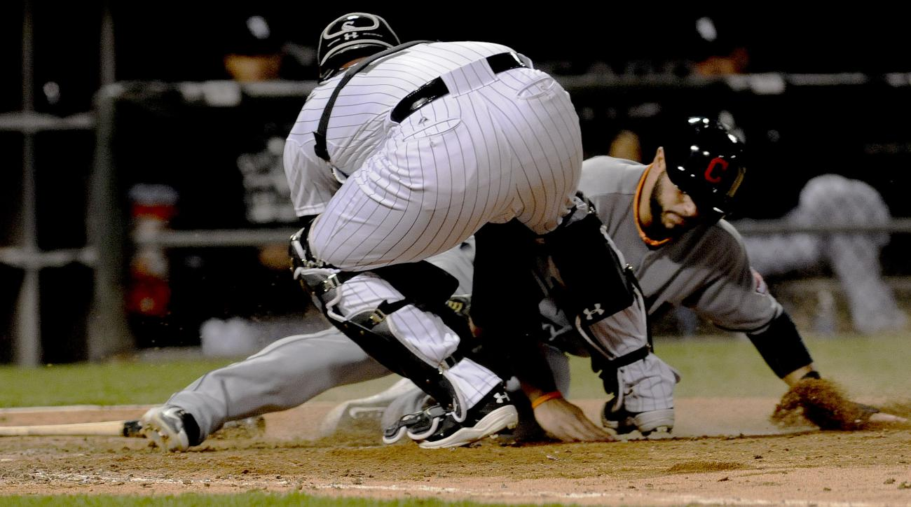 Chicago White Sox catcher Tyler Flowers tags Cleveland Indians' Mike Aviles out at home plate during the eighth inning of a baseball game  in Chicago on Thursday, May 21, 2015. (AP Photo/Matt Marton)